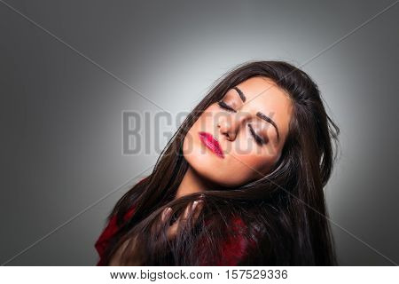 Portrait Of Gorgeous Young Woman With Closed Eyes, Profile On Grey Background