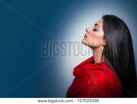 Portrait Of Gorgeous Young Woman With Closed Eyes, Profile On Blue Background