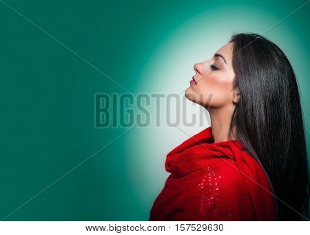Portrait Of Gorgeous Young Woman With Closed Eyes, Profile On Green Background