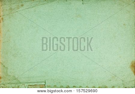 Green abstract exercise book cover textured page with folds stains torn border and fading effect
