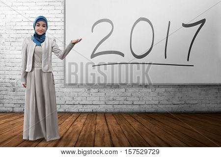 Smiling Muslim Business Woman Showing 2017 On The Board