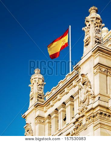 The Flag Of Spain Fluttering On The Cybele Palace In Madrid