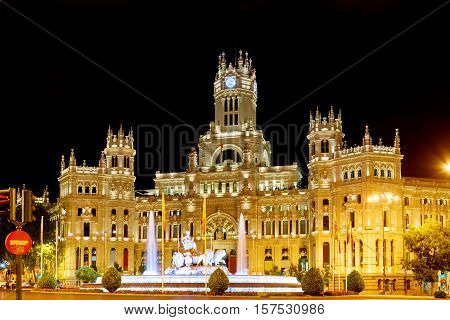 The Cybele Palace And The Fountain On The Cybeles Square (plaza De Cibeles) In Madrid At Evening
