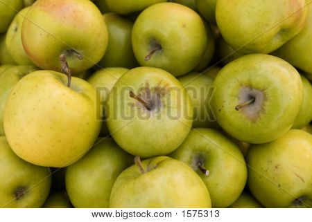 loose green mutsu apples on display in the fruit market poster