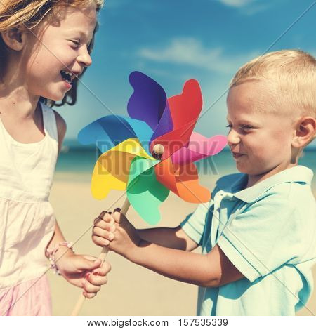 Kids Chlid Beach Sibling SIster Brother Blowing Concept