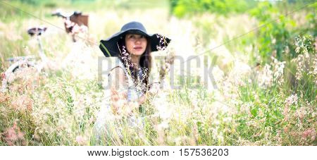 Blury woman in meadow. travel and sunset soft and select focus