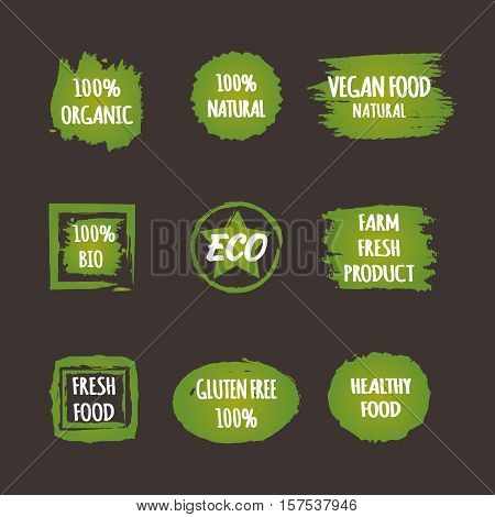 Set of green stickers with the text Vegan Food Natural 100% Organic Farm Fresh Product BIO ECO Gluten Free Healthy. Brush grunge.