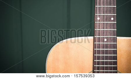 musical background image of acoustic guitar focus on strings with text area very shallow depth of field. Processed with vintage style.