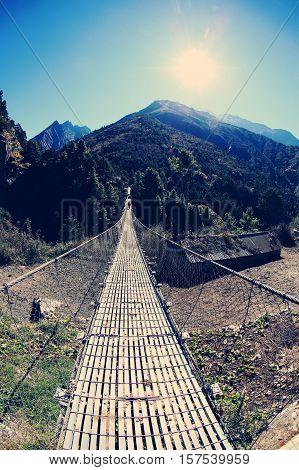 suspension bridge over the river in Sagarmatha National Park Himalayas Nepal