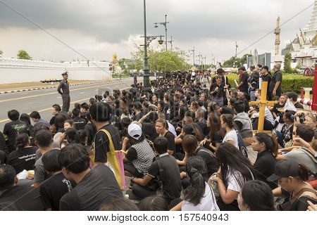 BANGKOK THAILAND - OCT 29 : The crowd of mourners on Sanam Chai road on the way to Sanam Luang while the funeral of king Bhumibol Adulyadej in Grand Palace on october 29 2016