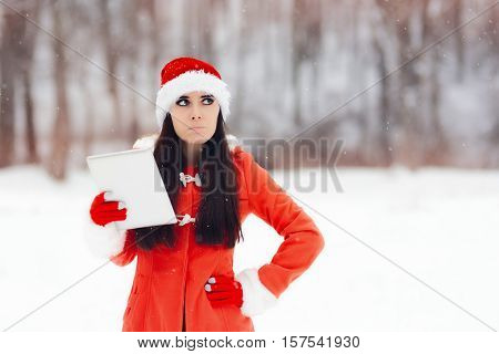 Disappointed Christmas Woman with Electronic Device Outside in the Snow