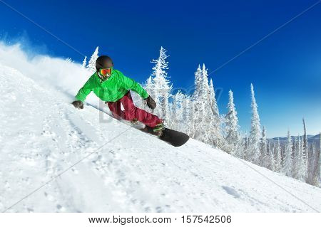 Active man snowboarder riding on slope. Snowboarding closeup. Sheregesh ski resort