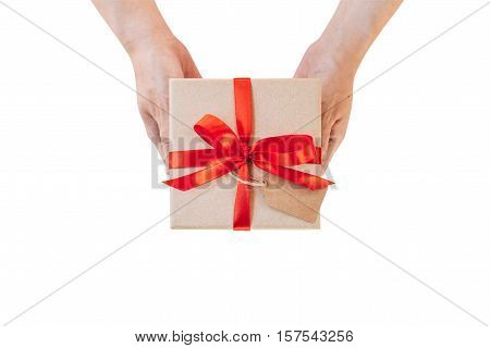 Hand Woman Holding Gift Box On Isolated With Clipping Path. Image Of Christmas Gift With Red Bow Pla