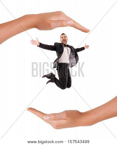 Confident Smart Looking Man Laughing and Jumping Up Enjoying Protection and insurance in the hands of Young Woman on white Background