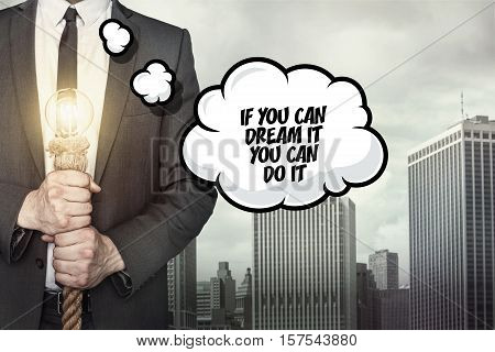If you can dream text on speech bubble with businessman holding lamp