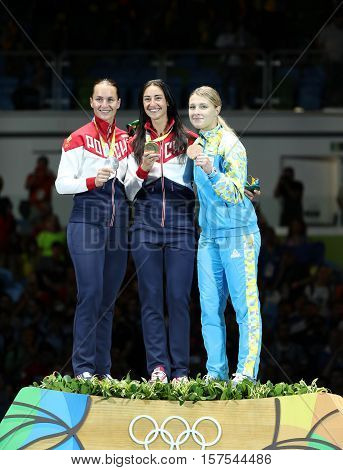 RIO DE JANEIRO, BRAZIL - AUGUST 8, 2016:Women's Sabre Individual winners at Rio 2016 Olympic Games Sofya Velikaya of Russia (L),Yana Egorian of Russia and Olga Kharlan of Ukraine during medal ceremony