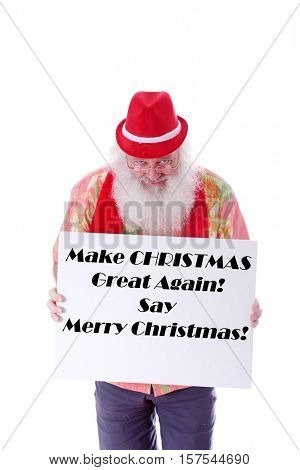 Hipster Santa Claus holds a white sign with text. Text can easily be removed and replaced with your text or images. Isolated on white with room for your text.