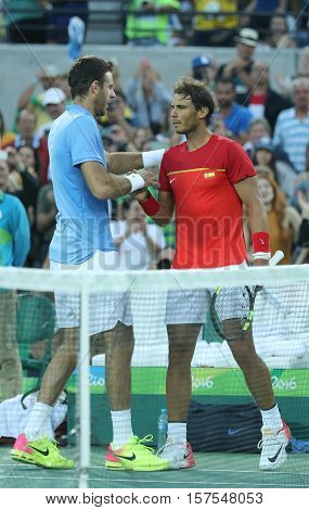 RIO DE JANEIRO, BRAZIL - AUGUST 13, 2016: Juan Martin Del Potro of Argentina (L) and  Rafael Nadal of Spain after men's singles semifinal match of the Rio 2016 Olympic Games at Olympic Tennis Centre