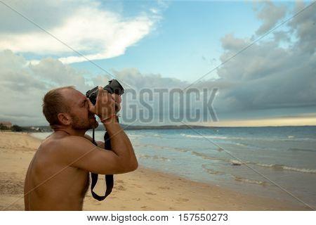 Professional photographer on the beach