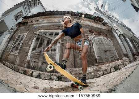 Skating girl against grange wall