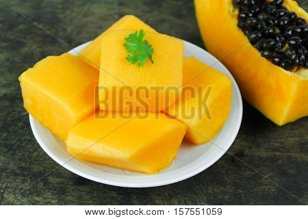 slice of sweet ripe papaya on white background