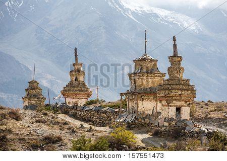 Traditional old Buddhist stupas on Annapurna Circuit Trek in Himalaya mountains, Nepal.