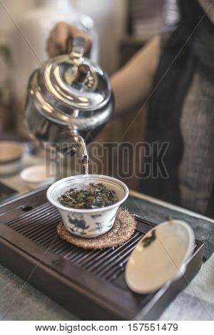 Chinese tea ceremony. Stylized desaturated photo