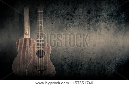 Part of a orange acoustic guitar on black background