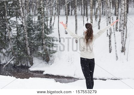 Sport woman running in winter. Female runner portrait in full body jogging in snow on cold winter day.