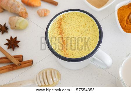 Turmeric latte Golden milk Turmeric milk made from turmeric almond mink cinnamon ginger and honey healthy hipster drink