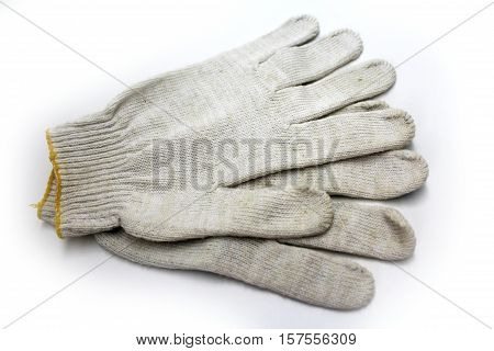 Working knitted gloves on white background. work clothes