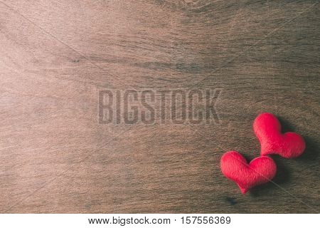 heart of fur on wood background valentine background in vintage style