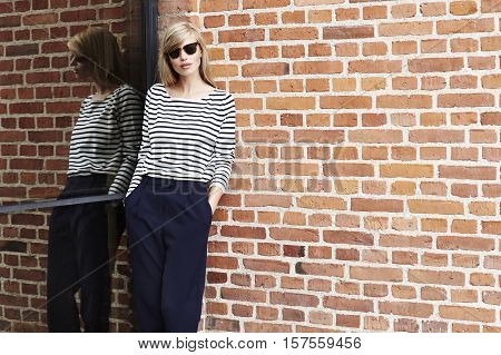 Cool girl in striped top and trousers
