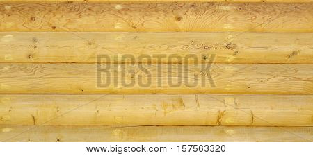 Old Hewn Natural Log Cabin Or Barn Wall Texture. Rustic Log House Vintage Wall Horizontal Background. Cracked Dry Wooden Debarked Log Rural Building Wall Structure. Abstract Web Banner