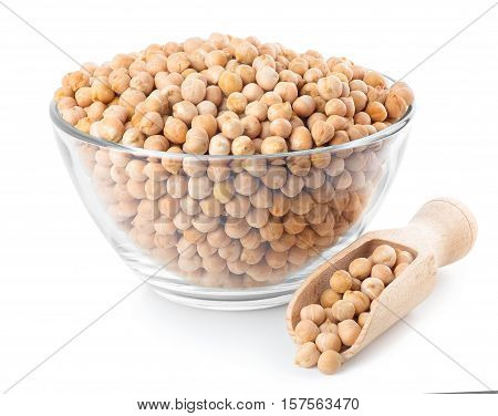 Dry chickpeas in glass bowl with wooden scoop isolated on white background. Uncooked chick-pea. Chickpea grains