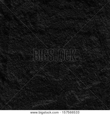 Dark grey black slate background or texture. black slate stone slab background or texture.