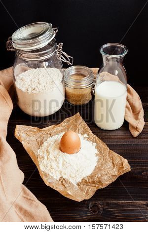 Home baking. Baking ingredients on the wooden dark table