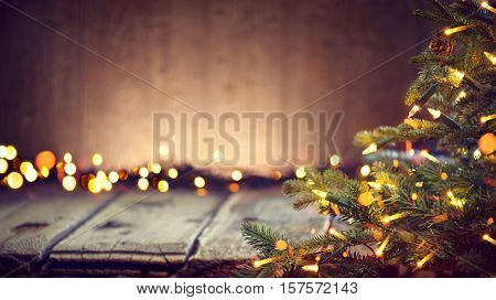 Christmas Holiday Background, Christmas table background with decorated Christmas tree and garlands. Beautiful Empty Christmas room. New Year Frame for your text