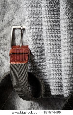 Black leather belt on background knit fabric