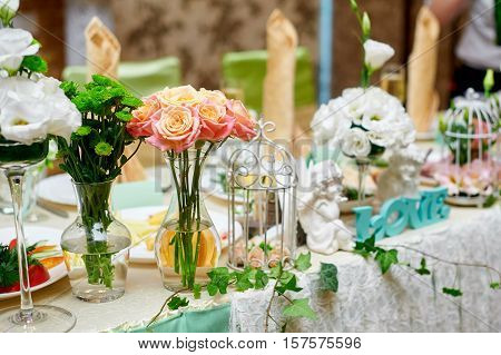 wedding table decorated with flowers and serving in the restaurant.