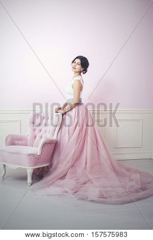 Woman Beautiful And Happy Pink Interior And Pink Long Dress