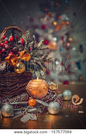 Christmas background with fir branches and decorations in basket. Space for text or design.