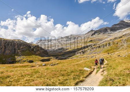 Mountain path with hikers on it on a clear summer day