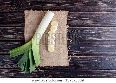Ripe fresh leek on wood desk. Food ingredients
