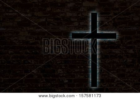 Glowing cross on a brick wall. Church background