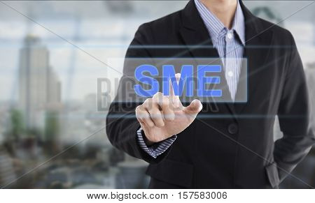 Businessman hand pressing button SME (Small and Medium Enterprises). sign on virtual screen. business concept.