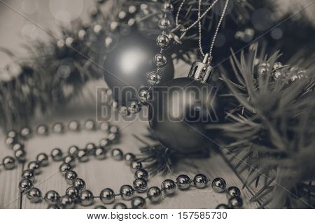 Christmas composition with fir banch bead and balls.New Year.Black and white