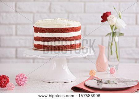 Delicious cake on white table