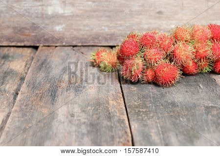rambutan sweet fruit fresh on wood background : Select focus with shallow depth of field.