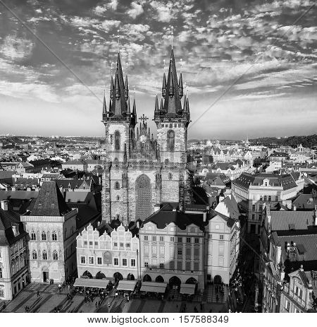 Old Town Square with Church of Our Lady before Tyn in eastern european Czech capital Prague - view from Town Hall, monochrome black and white image
